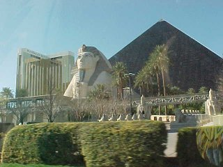 Luxor and Mandalay Bay with sphinx in foreground from car on Las Vegas Blvd side